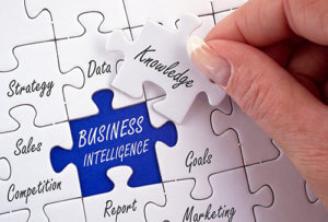 Stock photo of business intelligence puzzle pieces with words