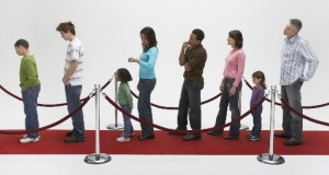 Stock photo of long queue of impatient people waiting
