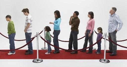 long queue of impatient people waiting