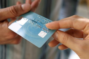 Stock photo of credit card transfering hands