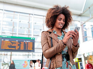 Stock photo of woman on cellphone