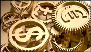 Stock photo of golden cogs with different international currency symbols