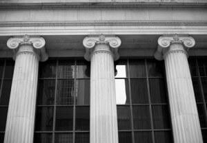 Stock photo of three pillars holding a building
