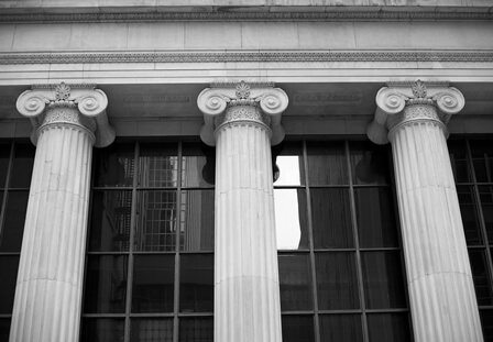 Stock photo of three pillars holding a building