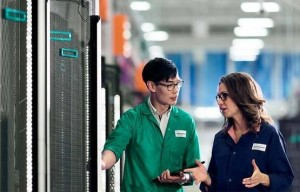 HPE stock photo of a man conversing with a woman in a server room